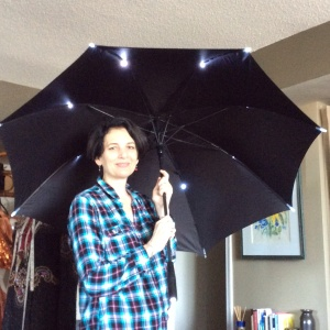 Roz showing me one of the light-up umbrellas her father imported.