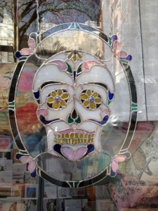 Day of the Dead stained glass in  Gastown window.